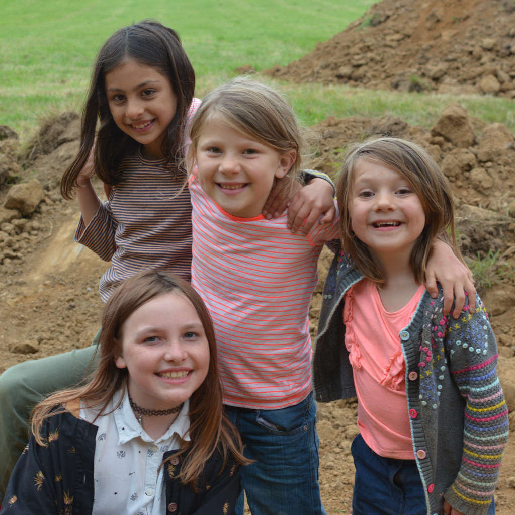 A group of children from BC together on the field the day building work started