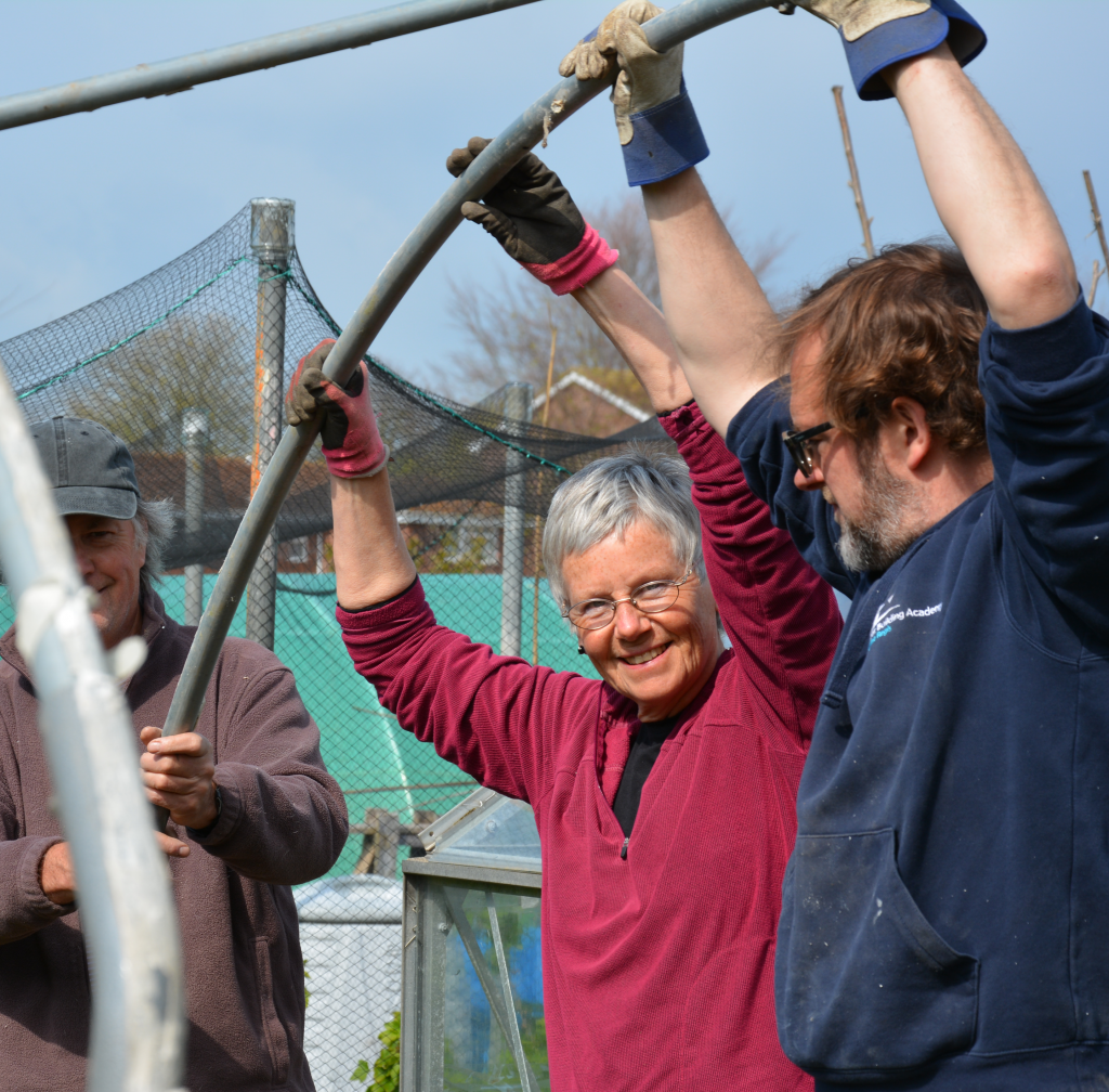 BC members working together to construct a pollytunnel frame